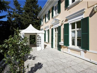 Photo for Beautiful apartment in an art nouveau villa with pool and spacious park