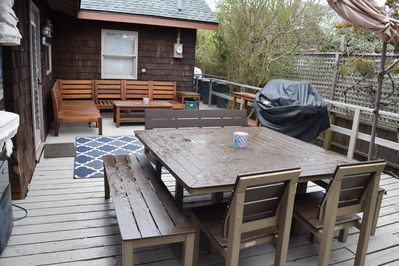 backyard.  table for 10-12 plus outside couch.  Weber grill.