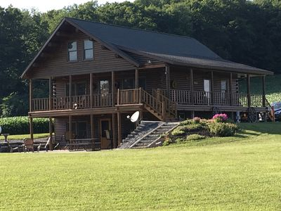 Stunning Log Home on Private Lake- Country at its best