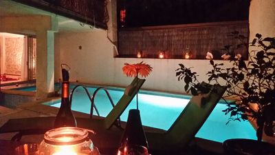 Poolside dining at night
