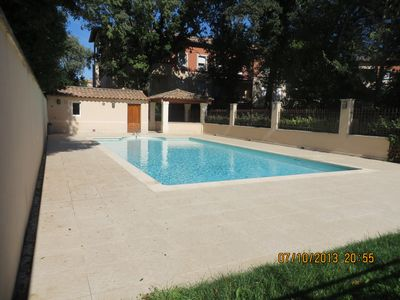 Photo for Luxury apt 300m from historic centre with sth facing bal, pool & garage