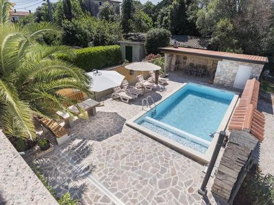Photo for Villa with heated pool on the edge of an olive grove overlooking the sea