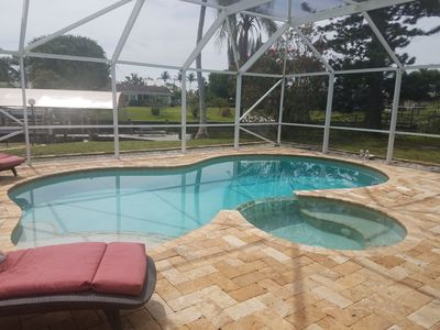 Photo for Waterfront home/Heated Pool w/ spa/boat lift/Yacht club area/Gulf Access