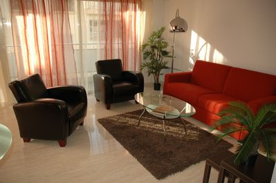 very bright living room with double sofa bed