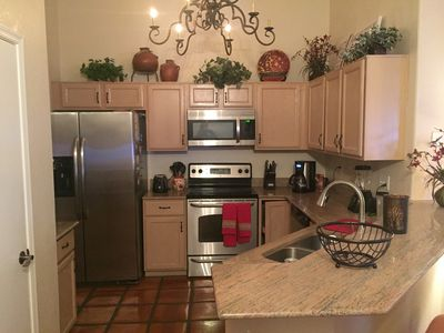 Kitchen hosts upgraded SS appliances and granite countertops