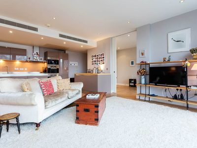 Photo for Modern 3BR with A/C and river views, easy access to Victoria Station (Veeve)