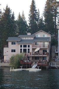Photo for Elegant, well-appointed 6 bedroom lakefront home with massive lake views, 3 decks, hot tub, private dock, gourmet kitchen and private dock!