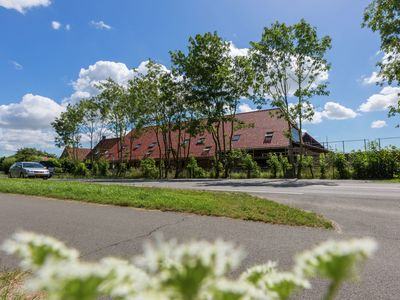 Photo for Luxury apartment with sun shower at the edge of the beautiful Oostkapelle