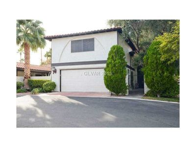 Beautiful gated community 4 bedroom 4 bath home located close to the Strip