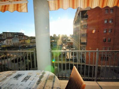 Photo for Sunny terrace close to the Stadium