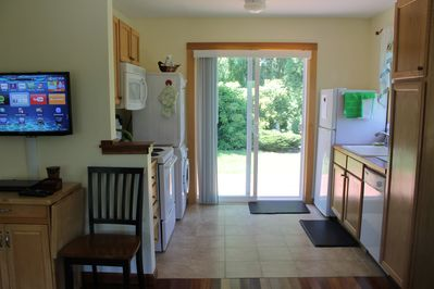 Smith Cottage kitchen: Washer/dryer, microwave, dishwasher; slider to backyard.