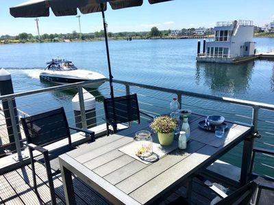 Photo for Floating cottage / houseboat On the Baltic Sea with three terraces and phenomenal water views - Private mooring - Sandy beach within walking distance ��� Sauna