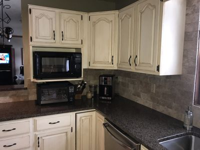 Updated stone backsplash, stainless sink and faucet