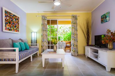 Welcome to our lovely beachfront 1-bedroom apartment! It is located right on inc