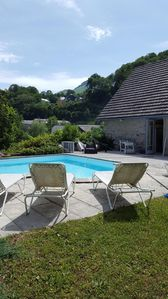 Photo for Pretty house with swimming pool in park raised with view on the peak of the montaigu