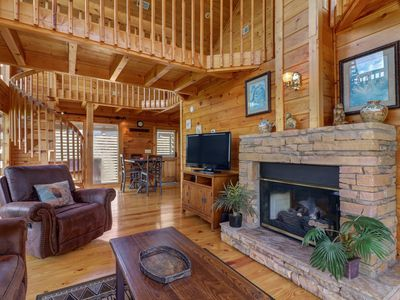 Photo for NEW LISTING! Hilltop home w/mountain view, hot tub, ping-pong & multi-level deck