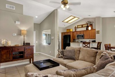 Open living, kitchen, dining area with a warm and cozy fire place perfect for those December nights