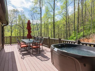 Photo for Super clean log cabin with hot tub, just 20 minutes to downtown Asheville. Biltmore pass included!