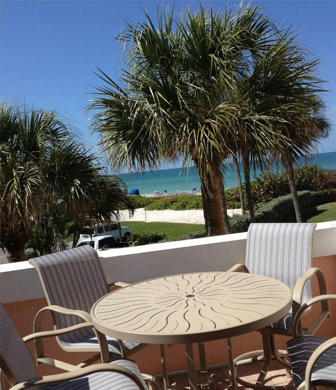 New Patio Furniture With Umbrella On The Balcony Of GULF FRONT Condo