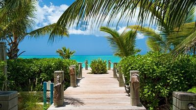 The boardwalk to the beach, just steps away from your villa