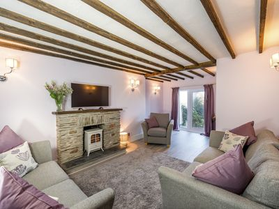 Photo for Spring Cottage enjoys stunning sea views and walks