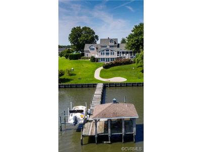 A private dock with boat lift and covered deck space will be your favorite place