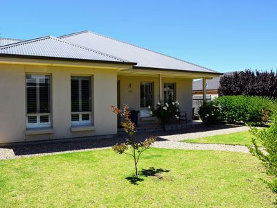 Photo for Immaculate & only a short distance from the beach - Pets welcome upon request