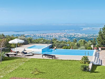 Photo for Stone villa w/ Ionian Sea views, Wi-Fi, air con + pool, easy walk to resort + amenities