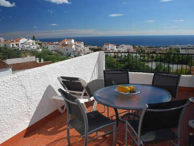 Photo for Townhouse with stunning views and pool area, large sunny terrace