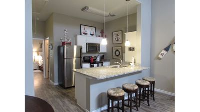 Photo for SUMMER is HERE !New Townhome, Walking distance to the BEACH, Resort Pool