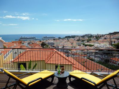Photo for Spacious balcony with one of the best views over the harbor and Funchal city.