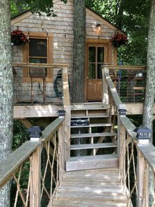 Photo for TREEHOUSE PARADISE serene nature w resort-like pool close to URI, trails, beach