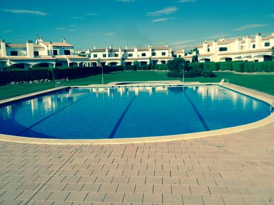 Photo for Sea Front 3 bedroom villa with private garden and large shared swimming poo