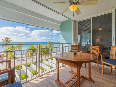 Photo for Ocean Breeze - Beautiful Top Floor Condo w/ Views of Smather's Beach, Private Balcony, Shared Pool