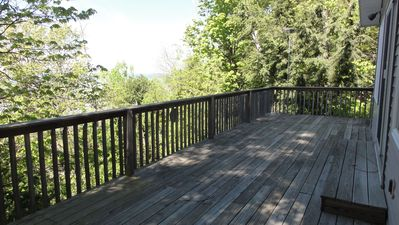 Oversized deck on south side of cottage facing Lake Michigan.