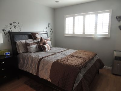 Bedroom with pillow top mattress   and quality bedding.