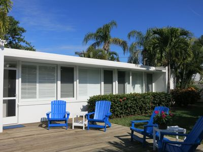 Front entry to our beach house with deck, chairs, and private yard.