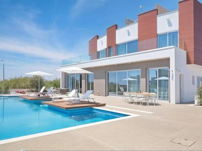 Photo for Amazing 3 Bedroom Luxury Villa on 2 Floors, A/C, Private Infinity Pool and only 70 m to the Beach!