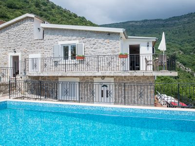 Photo for Hillside apartment with stunning views of sea and mountains, sea 2 km, pool