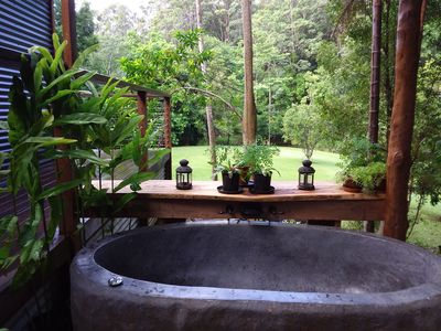 Volcanic Bali Bath on the deck, with views of rain forest garden and creek