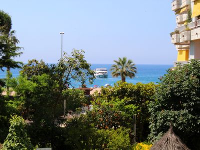 Photo for Beautiful apartment with sea views, pool and garden.
