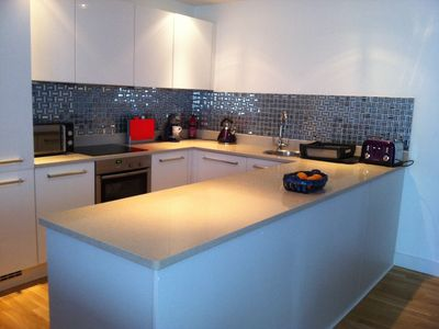 Photo for LUXURY APARTMENT PORTH, SLEEPS 4, SEA VIEWS OVERLOOKING WHIPSDERRY BEACH