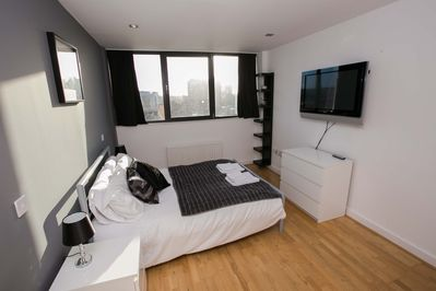 Master bedroom with double bed, wardrobes, wall mounted TV