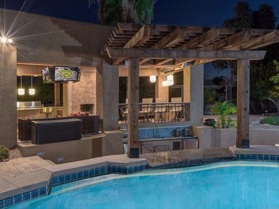 Photo for Luxurious living w/ a private pool, swim-up bar, outdoor kitchen
