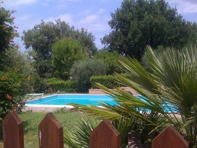 Photo for Elegant detached house in the countryside with an olive grove pool, close to the sea