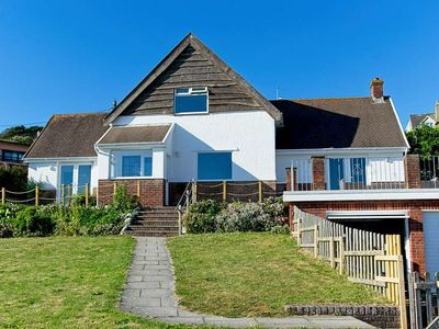 Photo for Amazing 3 bed cottage on Esplanade close to village and opposite main beach with fab views and garde