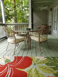 dine outside in screened comfort surrounded by lush vegetation