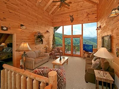 Photo for 2 bedroom cabin with wrap-around deck, hot tub, fireplaces, & free passes to local attractions.
