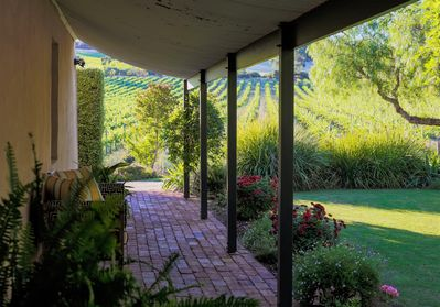 Enjoy the view from the verandah over the vineyards and gardens