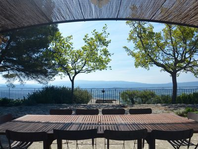 Photo for Spacious house with panoramic views of the Luberon valley and heated pool.